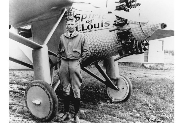 Charles Lindbergh, photographed alongside the 'Spirit of St. Louis'.