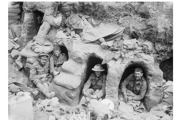 Men of the Border Regiment resting in shallow dugouts near Thiepval Wood during the battle of the Somme, August 1916. Ministry of Information First World War Official Collection. (Photo by Lt Ernest Brooks/IWM via Getty Images)