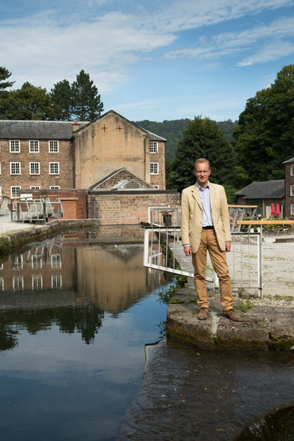 """Simon Thurley at Cromford Mills in Derbyshire. It was here, in 1771, that Richard Arkwright set up his first water-powered mills, """"bringing people to a single place where they could be organised into an efficient workforce"""". (BBC History commissioned portrait by Mike Abrahams)"""