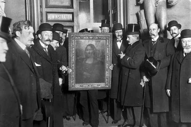 People gather around the Mona Lisa painting on January 4, 1914 in Paris France, after it was stolen from the ouvre by Vincenzo Peruggia in 1911. (Photo by Roger-Viollet/Getty Images)