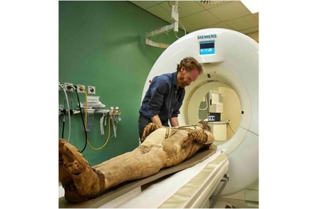 An Egyptian mummy receiving a CT scan