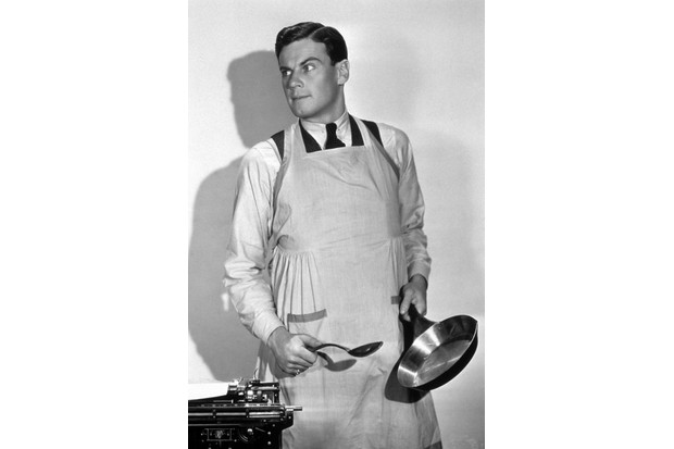 Actor Norman Foster preparing to cook in a still from the 1931 Paramount film 'Up Pops The Devil,' in which a wife supports her husband so that he can write novels. (Photo by Hulton Archive/Getty Images)