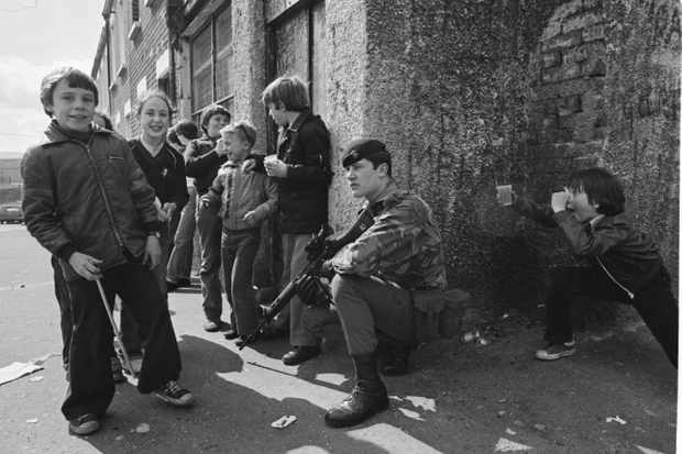 Children Playing Near a British Soldiers in Belfast