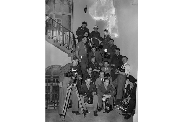 Photographers gathered on a staircase outside the courtroom at the end of the Nuremberg Trials, October 1946. Photographers were excluded from the courtroom as the verdicts were read out. (Photo by Fred Ramage/Keystone/Hulton Archive/Getty Images)