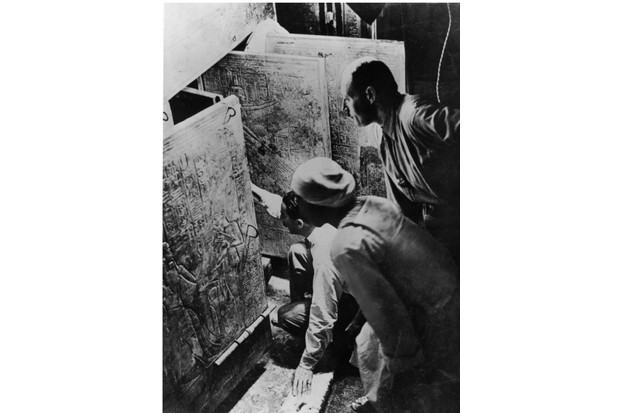 British archaeologist and Egyptologist Howard Carter (left) and his assistant Arthur Callender opening the entrance to Tutankhamun's tomb. (Hulton Archive/Getty Images)