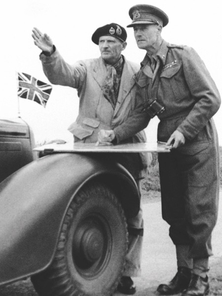 Britain's General Bernard Montgomery, left, in the forward area, talks with Lieutenant General Crocker 2nd Army Corps Commander, as they watch shells bursting on enemy positions, South of Caen, France, on July 15, 1944. (AP Photo)