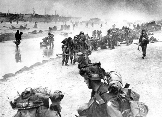 British troops move on the Normandy shore from their landing craft on June 6, 1944 during the D-Day invasion of German occupied France during World War II. (AP Photo)