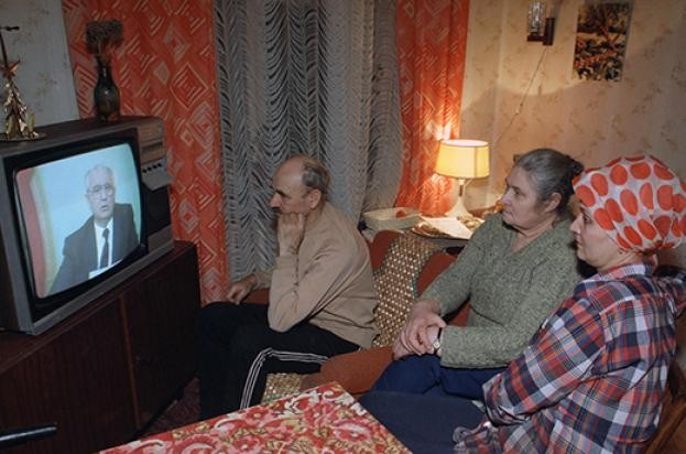 The Musichick family watches Soviet president Mikhail Gorbachev's resignation speech on Soviet television from their Moscow apartment. (PA)