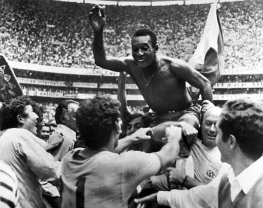 Brazil's soccer star Pele is hoisted on the shoulders of his teammates and fans after Brazil won the ninth World Cup final against Italy. (AP Photo)