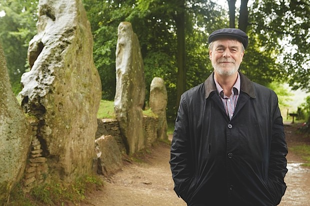 Professor Richard Bradley investigates the Neolithic tomb of Wayland's Smithy. The stone monument we see today hides an earlier wooden structure that held the remains of 14 people. (Photo by Oliver Edwards)