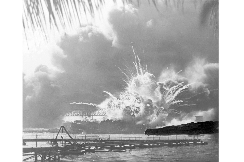 The destroyer USS Shaw explodes in a massive fireball at Pearl Harbor, 7 December 1941. The attack led almost immediately to Germany declaring war on America, and so brought Stalin an unexpected ally of colossal potential power, says Laurence Rees. (Bettmann/Getty Images)