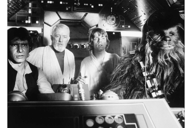 Peter Mayhew, Harrison Ford, Alec Guinness and Mark Hamill, on-set of the film Star Wars