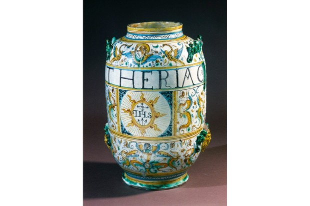 ITALY - MARCH 29: Tin-glazed earthenware drug jar (or albarello) from Rome or Deruta, used by the Jesuits and intended for storing theriac. Theriac was an electuary (medicinal paste) used as an antidote to venomous snake bites. The flesh of the snakes themselves was an essential ingredient. Later, theriac was compounded to various formulas and was regarded as a universal antidote and panacea. The first London pharmacopoeia of 1618 contained a recipe for Theracia Andromachi (Venetian Treacle). In various towns such as Venice and Montpellier, theriac was prepared in public under official supervision to ensure the correct composition of the remedy. (Photo by SSPL/Getty Images)