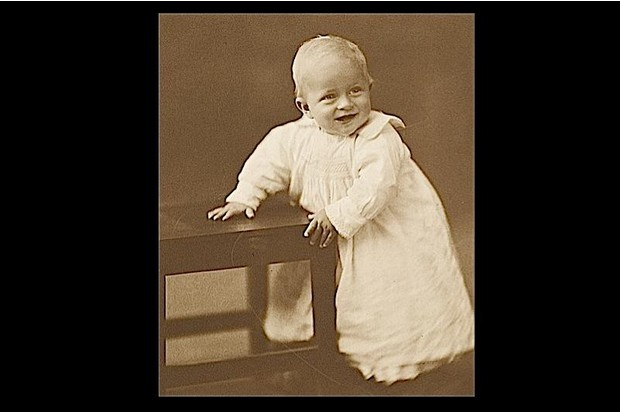 A sepia photograph of Prince Philip, husband of Queen Elizabeth II, as a baby.