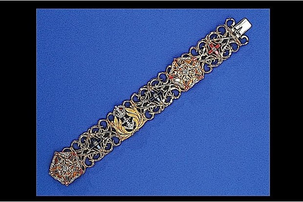 A bracelet made from gold, diamond, sapphire and ruby.