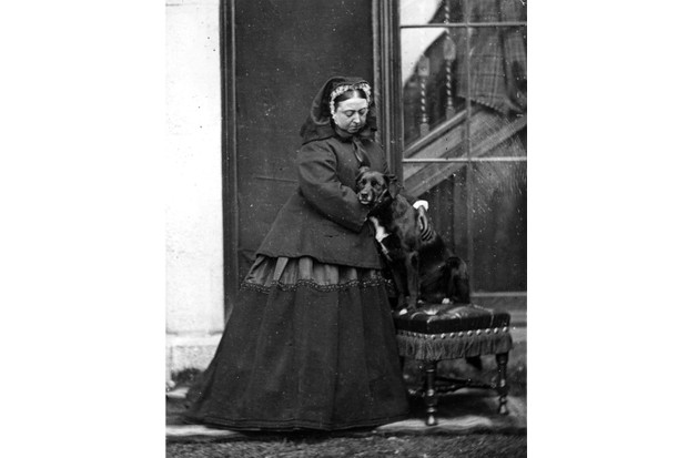 Queen Victoria with her pet dog named Sharp at Balmoral Castle in Scotland, 1867. (Photo by W& D Downey/Getty Images)
