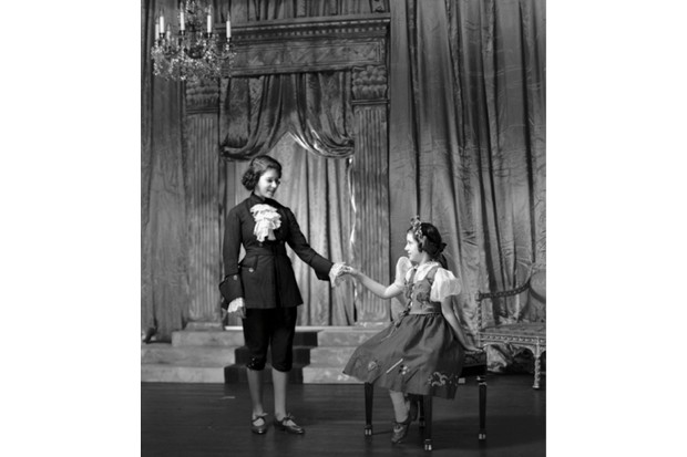 Princess Elizabeth (Queen Elizabeth II) dressed as Prince Charming with Princess Margaret (1930-2002) as Cinderella during a royal pantomime at Windsor Castle, Berkshire, 21 December 1941. (Photo by Lisa Sheridan/Studio Lisa/Getty Images)