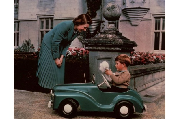 Princess Elizabeth watching Prince Charles playing in his toy car while at Balmoral, 28 September 1952. (Photo by Lisa Sheridan/Studio Lisa/Getty Images)