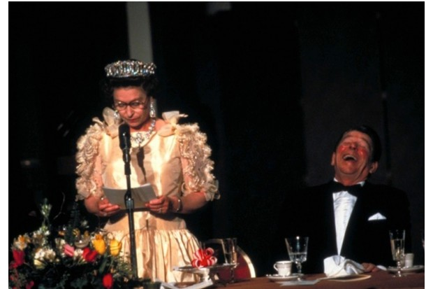 President Ronald Reagan roars with laughter at a joke delivered by Queen Elizabeth II during a state dinner in San Francisco, March 1983. The 'deadpan'-style joke remarked on the California weather. (Photo by Diana Walker/The LIFE Images Collection/Getty Images)