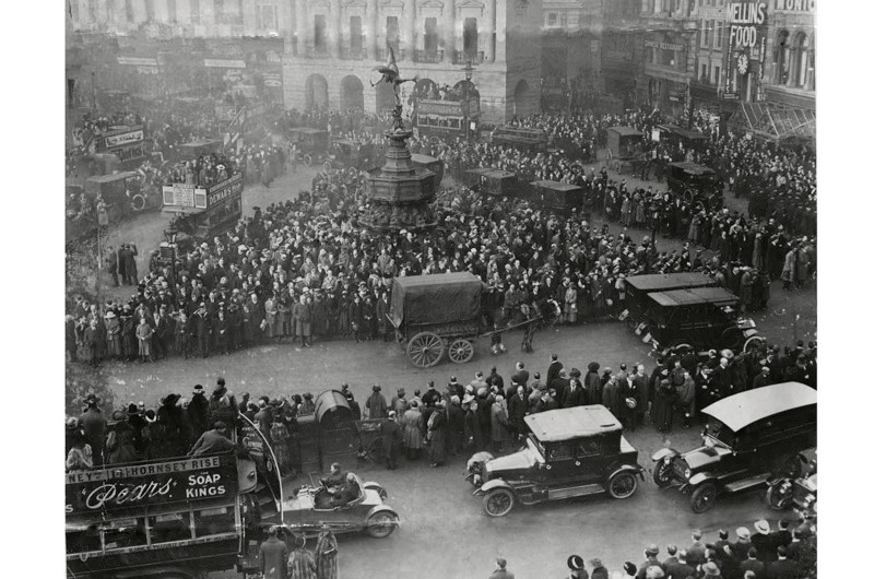 Londoners observe a two minutes' silence at Piccadilly Circus on 11 November 1919. Remembrance Day 1919 was a sombre occasion, eschewing triumphalism. (Rex Features)