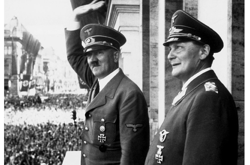 Adolf Hitler and Hermann Göring on the balcony of the Reichs Chancellery, Berlin. One British journalist recalled how, in 1933, Göring began an attack against the foreign press unlike any he had previously witnessed. (Photo by © CORBIS/Corbis via Getty Images)
