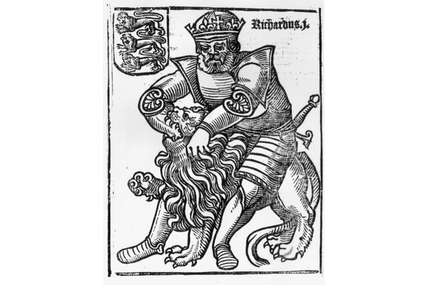 Circa 1180, Richard I (1157 - 1199) King of England (1189-1199), known as Lion Hearted, plunging his fist into a lion's throat. (Photo by Hulton Archive/Getty Images)