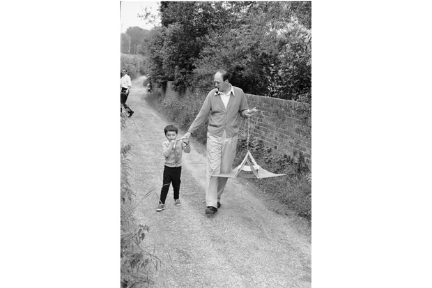 Roald Dahl walks with his five-year-old son, Theo, along a pathway in Missenden, Buckinghamshire, England, late 1965. (Photo by Leonard McCombe/The LIFE Picture Collection/Getty Images)
