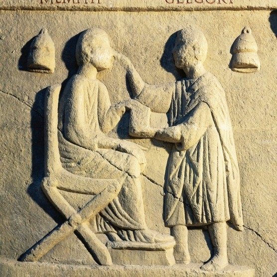 Roman civilization, a relief portraying an ophthalmologist examining a patient. (Photo By DEA/A DAGLI ORTI/De Agostini/Getty Images)