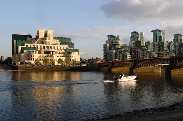 The SIS Building from across the River Thames, London. Designed by architect Terry Farrell, this building has been the headquarters of MI6 since its completion in 1994. It has been nicknamed 'Babylon-on-Thames' because of its perceived resemblance to a Babylonian ziggurat. Vauxhall Bridge is on the right. (Photo by Peter Thompson/Heritage Images/Getty Images)