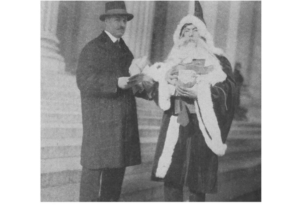 John Duval Gluck, Jr, 'the Santa Claus man', pictured left with King Baggot (in Santa costume) visiting the General Post Office to promote the Santa Claus Association's benefit show. Image from the Santa Claus Annual. (Photo by Gluck Scrapbooks)