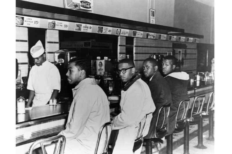 Four black students in Greensboro, North Carolina, hold the first sit-in (Corbis.)