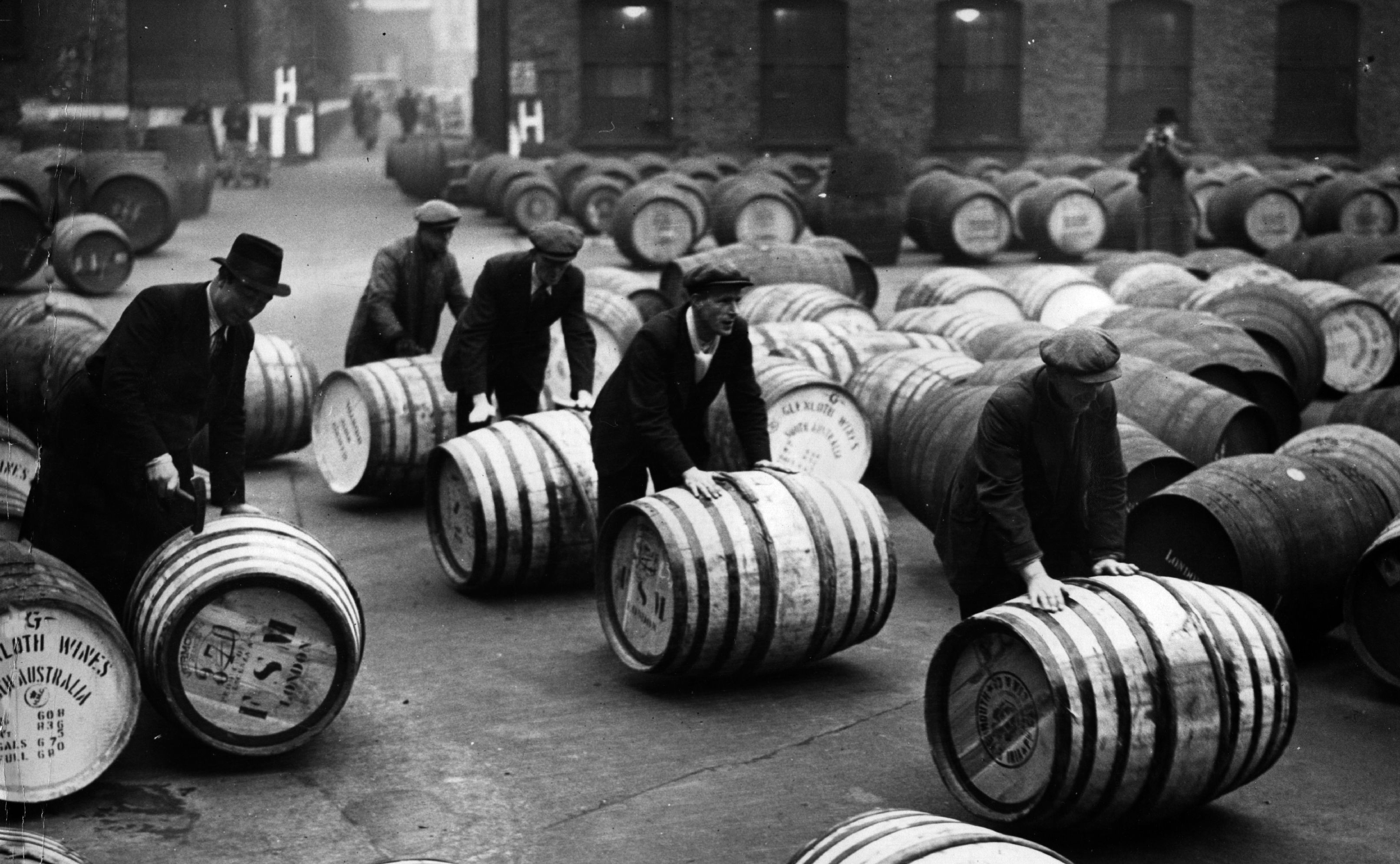 Dockers unloading wine barrels