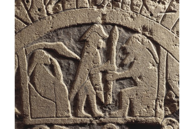 Detail of a stone relief representing the divine triad of the Vikings