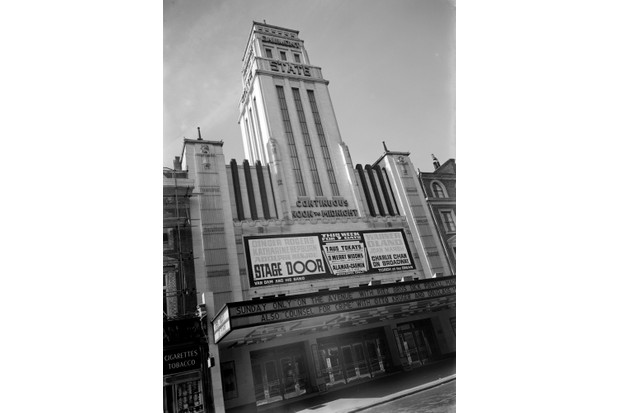 Gaumont State Cinema, Kilburn High Road, London, c1937. Entrance front to the cinema. The exterior is in faience and is in the Art Deco style, with the emphasis on linear detailing. It was designed by George Coles and opened in 1937. The films 'Stage Door' and 'Charlie Chan on Broadway' are the current attractions. (Photo by English Heritage/Heritage Images/Getty Images)