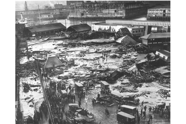 This image depicts the widespread damage in Boston's North End caused by the explosion of a molasses tank in January 1919. (The Boston Globe via Getty Images)