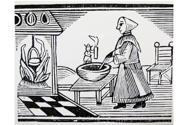 'The Famous History of Tom Thumb'. Tom holds a candle so his mother can see to cook. Late 18th-century woodcut. (Photo by, Universal History Archive/UIG via Getty Images)