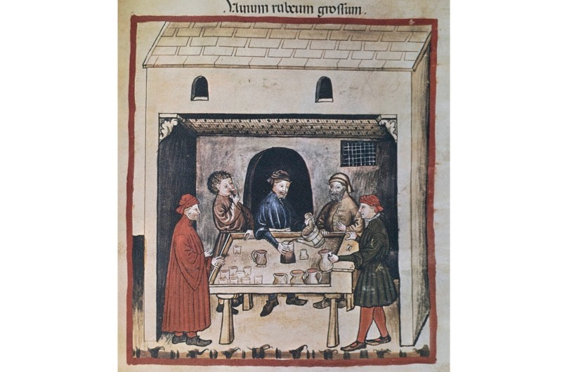 This 14th-century miniature shows men enjoying a glass of red wine. Alcohol features prominently in medieval and Tudor accounts of breakfast. (DeAgostini/Getty Images)