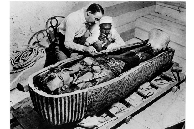 Howard Carter removing oils from the coffin of Tutankhamun. (Photo by Mansell/Mansell/The LIFE Picture Collection/Getty Images)