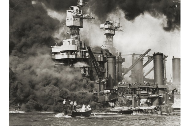 Rescue boats move in on the battleships USS West Virginia (foreground) and USS Tennessee after the Japanese surprise attack on Pearl Harbor. (Bettmann/Getty Images)