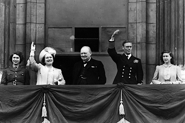 British prime minister Winston Churchill with the royal family, waving from the balcony of Buckingham Palace during VE Day celebrations. (Photo by Reg Speller/Getty Images)