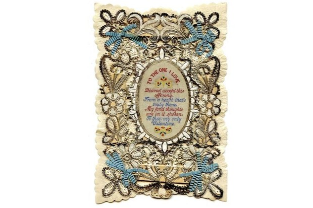 "A heavily embroidered Valentine's day card containing a verse that begins: ""To the one I love""."