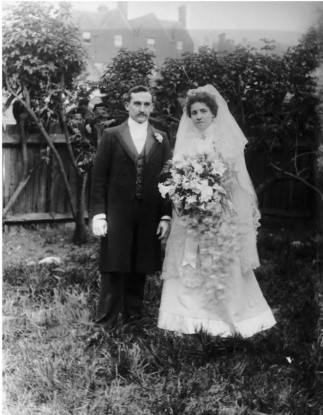 Victorian20bride20and20groom20pose20in20the20garden_0-14a58cc