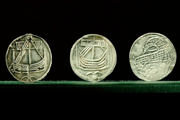 Coins depicting Viking longships, probably minted at Hedeby, Denmark, dating from the early 9th century. The Viking era began in the ninth century and ended in 1066, when the Norwegian king Harald Hardrada was defeated at the battle of Stamford Bridge. (Photo by Werner Forman/Universal Images Group/Getty Images)