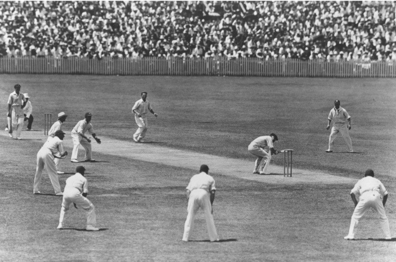 WM Woodfull of Australia ducks to avoid a rising ball from Harold Larwood of England during the Fourth Test match at Brisbane on the infamous 'Bodyline' Tour of Australia.   (Photo by Central Press/Getty Images)