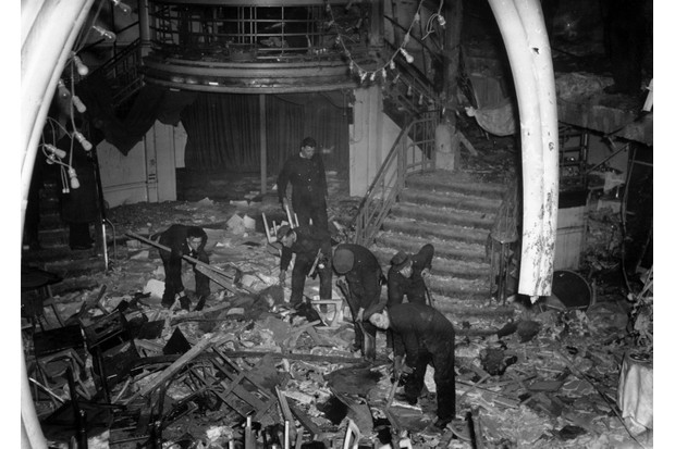 Emergency workers clear out the bomb-damaged interior of the Cafe de Paris. (Reg Speller/Fox Photos/Getty Images)