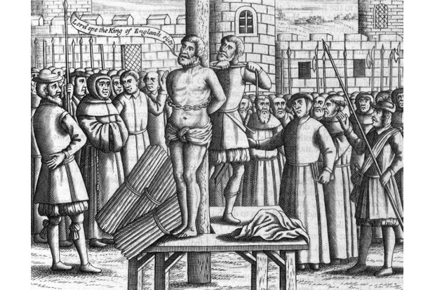 William Tyndale being tied to a stake before being strangled and burned to death. (Photo by Hulton Archive/Getty Images)