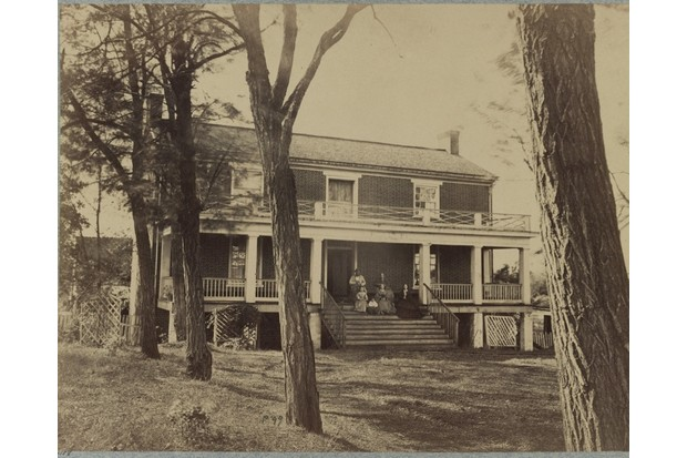 APPORMATTOX, VA - APRIL: In this image from the U.S. Library of Congress, Wilmer McLean and his family sit on the porch of his house, where Confederate Gen. Robert E. Lee signed the terms of surrender to U.S. Gen. Ulysses S. Grant, in April, 1865 in Appomattox, Virginia. (Photo by Timothy H. O'Sullivan/U.S. Library of Congress, via Getty Images)