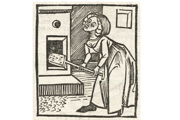 Woodcut of a woman who may be stoking a furnace or baking bread, printed in the 15th century. (SSPL/Getty Images)
