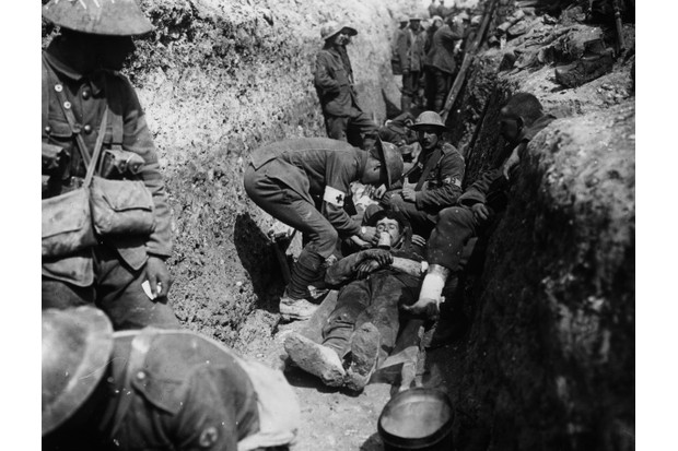 A wounded soldier in the trenches on the British Front on 1 July 1916, the first day of the battle of the Somme. (Photo by Robert Hunt Library/Windmill Books/UIG via Getty images)