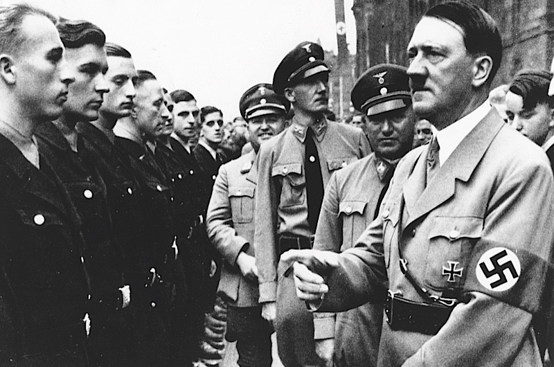 Hitler meets members of the Reich Labour Service. (Photo by AKG)